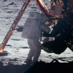 Neil Armstrong placing US flag on the moon