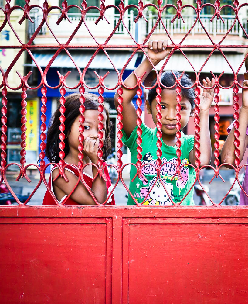 Street Photography in Phnom Penh, Cambodia by Tim Kelsall - children outside the Teochiu Temple