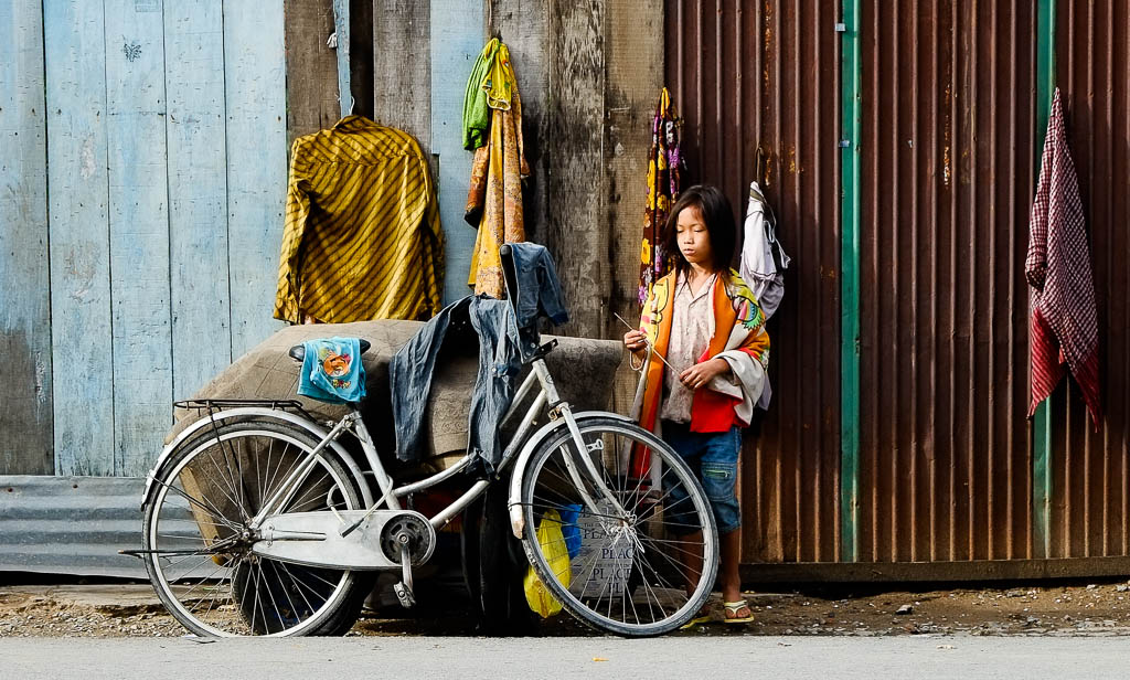 Street Photography in Phnom Penh, Cambodia by Tim Kelsall - girl with a bicycle