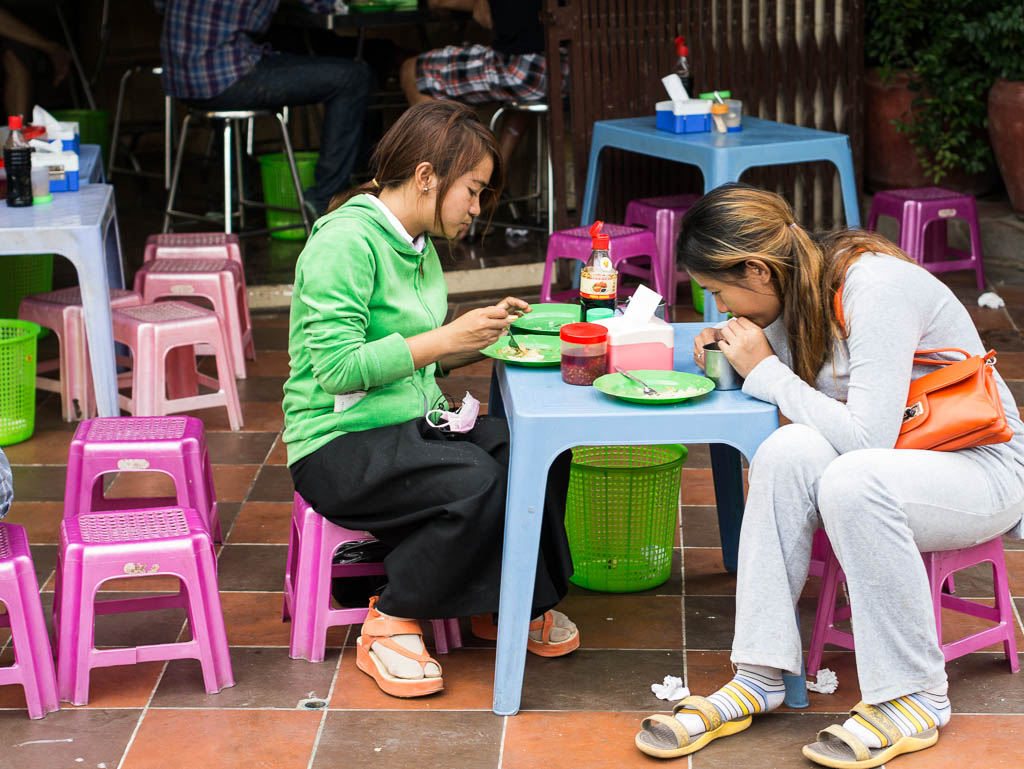 Street Photography in Phnom Penh, Cambodia by Tim Kelsall - two women eating in street 13