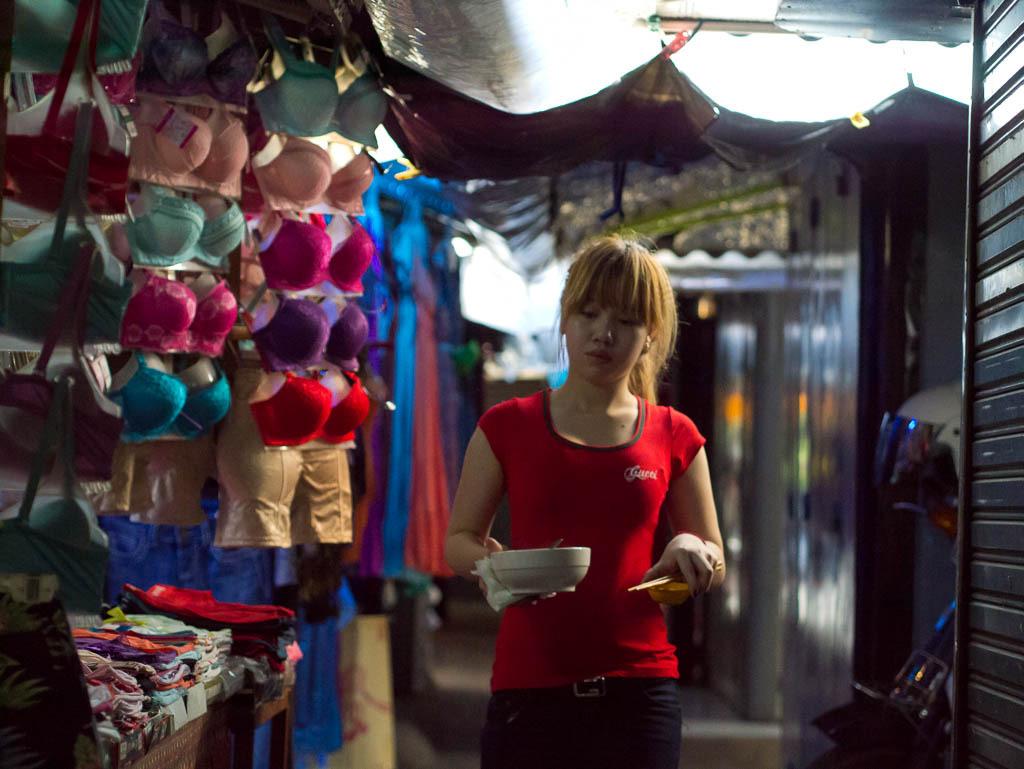 Street Photography in Phnom Penh, Cambodia by Tim Kelsall - woman in Psar Chas Old Market