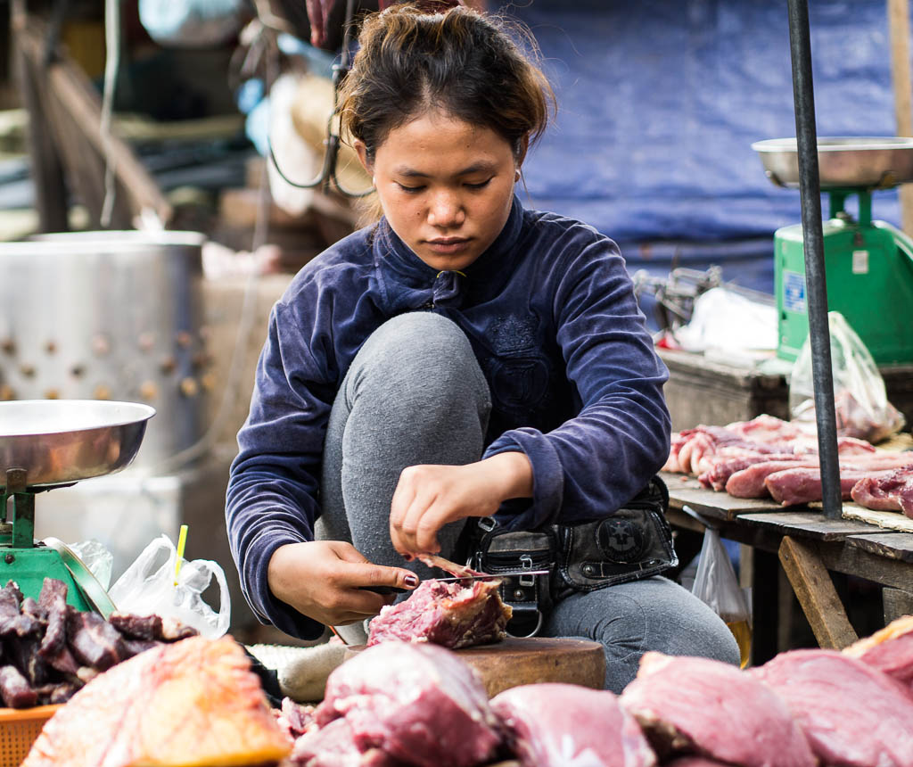 Street Photography in Phnom Penh, Cambodia by Tim Kelsall - woman working in Psar Chas Old Market