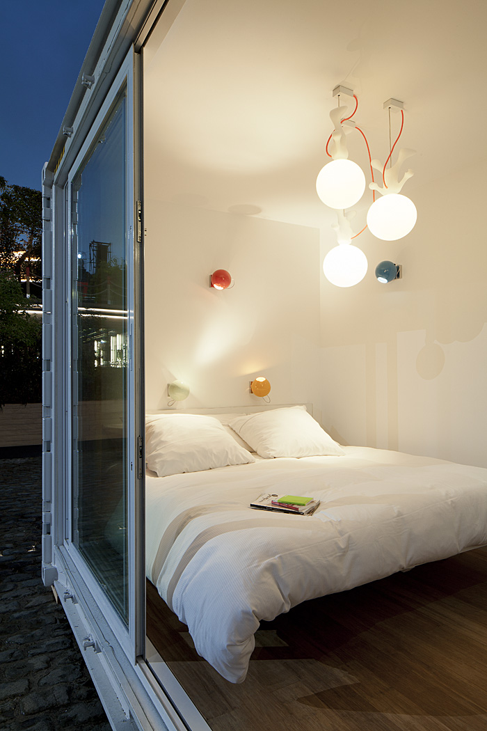 Sleeping Around Pop Up Hotel bedroom at night